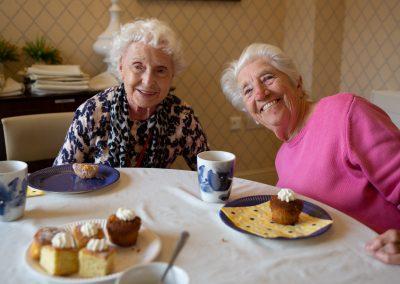 Residents of Acacia Mews enjoying tea and cake while the NCS choir sing