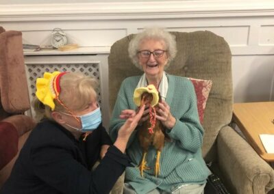 Creative residents knitting chicken hats!